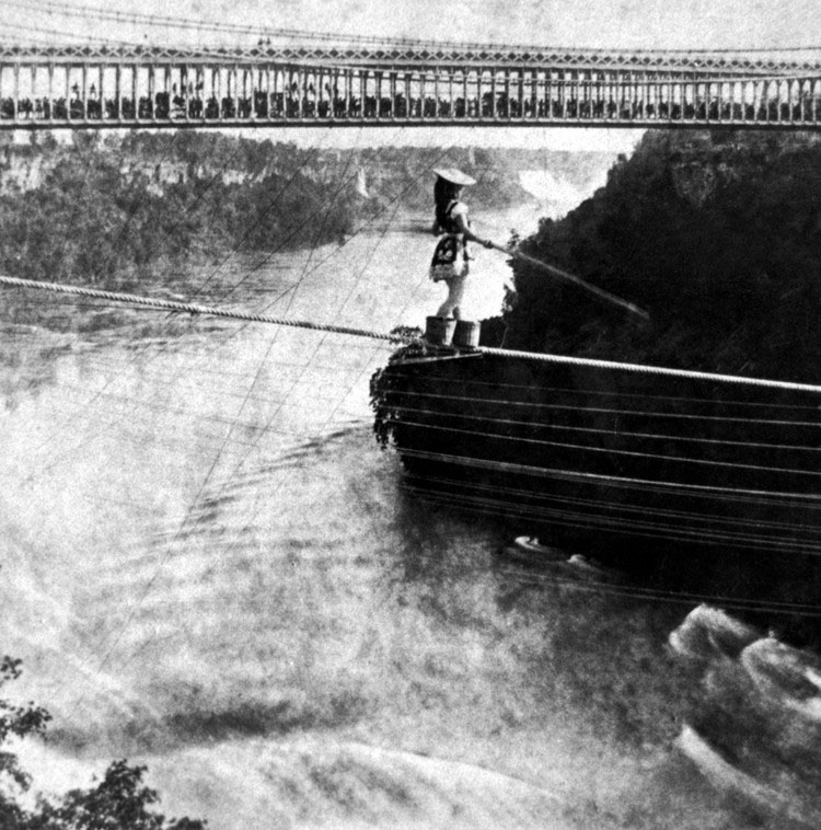 This picture represents what we wish we could explain but can't.  Photo from: http://en.wikipedia.org/wiki/File:Maria_Spelterini_at_Suspension_Bridge.jpg