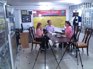 Mrs. Lyna Tan, Mr. Meas Savong, and Mrs. Samoeun Intal filming The Bible: God's Instructions for Life video.