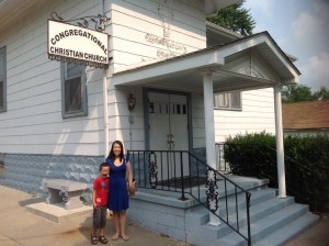 Kayo and Benjamin in front of a church in a small town in IL where Darryl went to church as a young child.  The church Darryl's father pastored closed because the young people moved away and the older generation passed away.