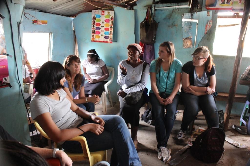 The women of CCHD teach a study at a salon in Kibera.