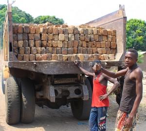 Old Hino brings bricks for the wall. Congo.