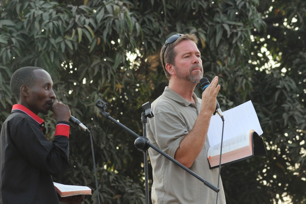 Pastor Brian preaching at the Concert.